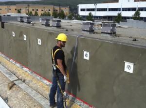 Worker installing stucco