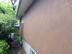 side of stucco bungalow calgary